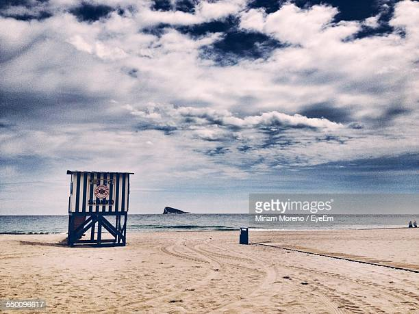 Lifeguard Tower At Beach Against Cloudy Sky