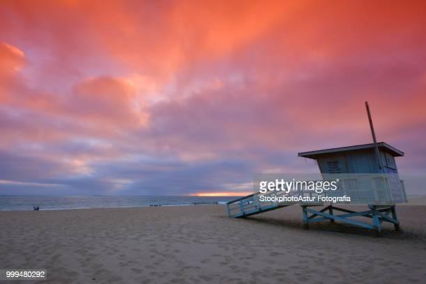 Lifeguard tower at sunset at Hermosa Beach, California