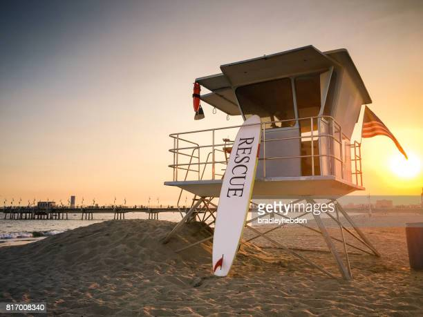 Lifeguard tower at sunset near pier in Long Beach, CA
