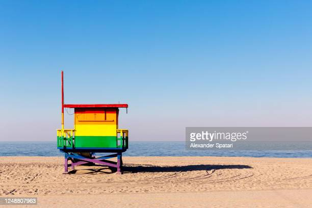 lifeguard tower colored in rainbow in venice beach, los angeles, usa - los angeles stock pictures, royalty-free photos & images