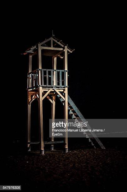 Lifeguard Tower On Beach Against Sky At Night