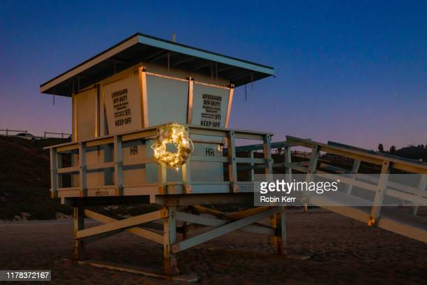 lifeguard tower with life preserver wreath at christmas - torrance stock pictures, royalty-free photos & images