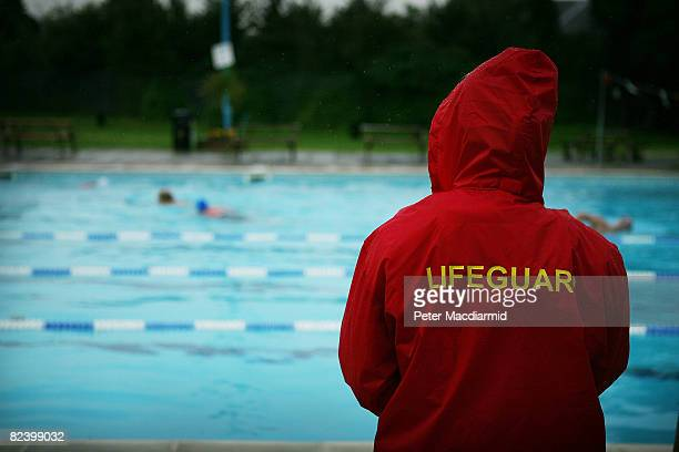 A lifeguard watches as swimmers enjoy the water at Hampton outdoor heated pool on August 18 2008 in London At one time London could boast more that...