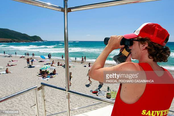 A lifeguard watches out for swimmers on Capo di Feno beach on July 30 in Ajaccio AFP PHOTO / PASCAL POCHARDCASABIANCA