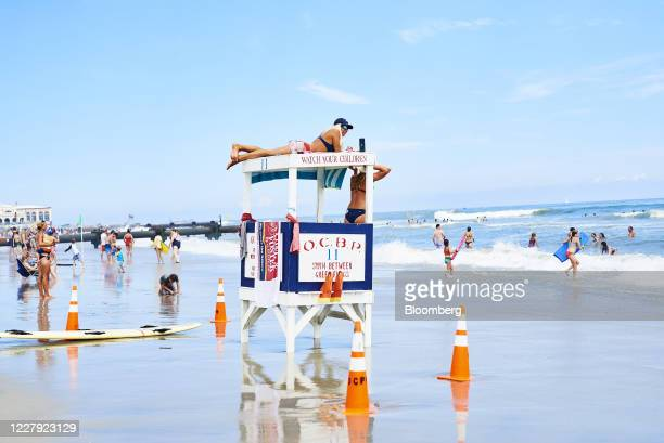 Lifeguard watches swimmers at a beach in Ocean City, New Jersey, U.S., on Saturday, Aug. 1, 2020. From California's wine country to Colorado's ski...