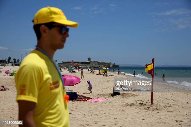 A Lifeguard watches the Carcavelos beach in Cascais Portugal on June 6 on the official opening of the bathing season as local authorities ease...