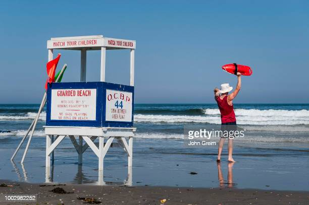 Lifeguard waving swimmers to shore in Ocean City.