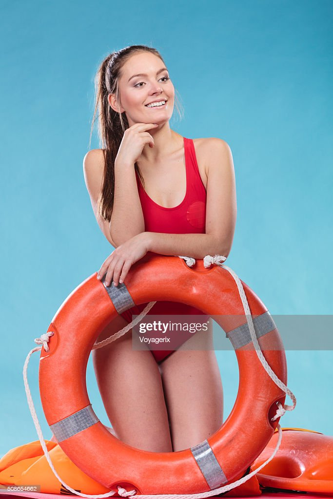 Lifeguard woman on duty with ring buoy lifebuoy. : Stock Photo