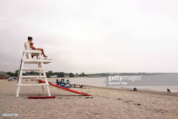 A lifeguard works at a largely empty Compo Beach on August 31 2014 in Westport Connecticut Beachgoing has been mostly subdued this Labor Day weekend...