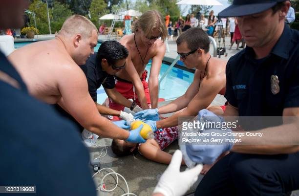 Lifeguards and Orange County Fire Authority personnel attend to mockdrowning victim Katrina Silva of Mission Viejo during Water Safety Day at the...