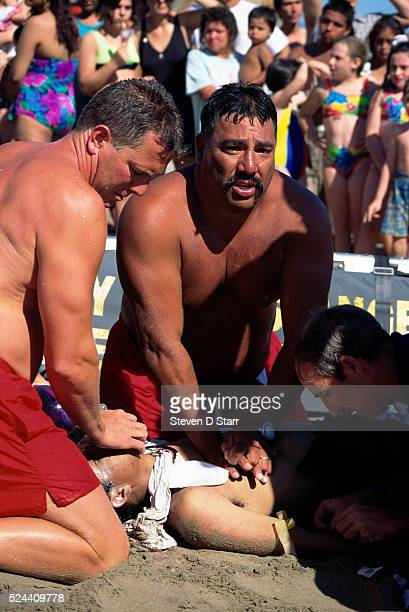 Lifeguards at the beach in Santa Monica attempt to revive a drowning victim