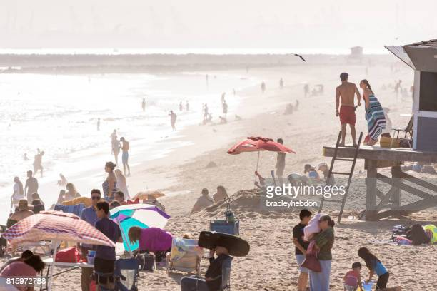 lifeguards discuss surf conditions from tower in seal beach, ca - seal beach stock pictures, royalty-free photos & images