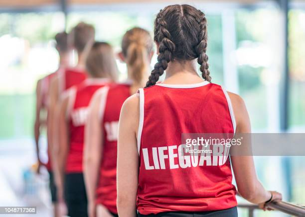 lifeguards in a line - lifeguard stock pictures, royalty-free photos & images