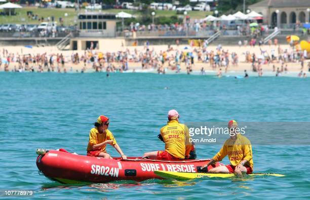 Lifeguards patrol the surf at Bondi Beach on December 25 2010 in Sydney Australia