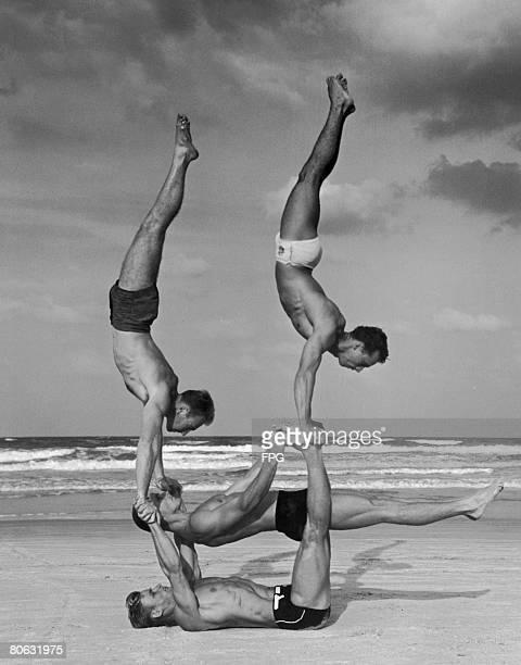 Lifeguards performing acrobatics at Daytona Beach Florida circa 1940