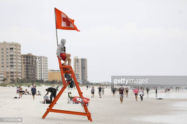 Lifeguards watch over swimmers on the beach in Jacksonville Beach Florida US on Saturday April 18 2020 The beaches and parks have now been reopened...