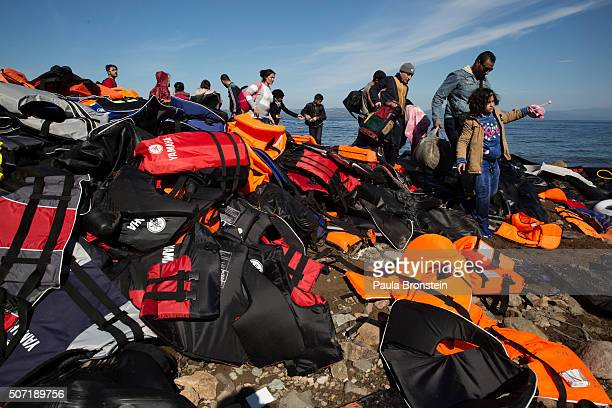 Lifejackets are seen everywhere as another raft lands filled with more refugees from Turkey on October 26 2015 in LEsbos Greece Cold weather and...
