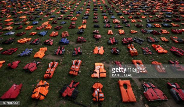 2500 lifejackets worn by refugees during crossings from Turkey to the Greek island of Chios are displayed on Parliament Square opposite the Houses of...