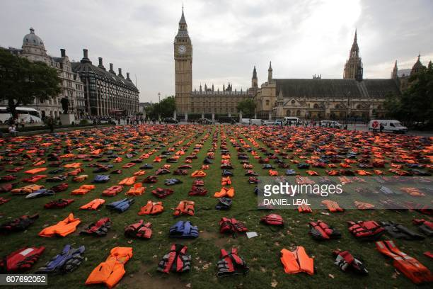 TOPSHOT 2500 lifejackets worn by refugees during crossings from Turkey to the Greek island of Chios are displayed on Parliament Square opposite the...