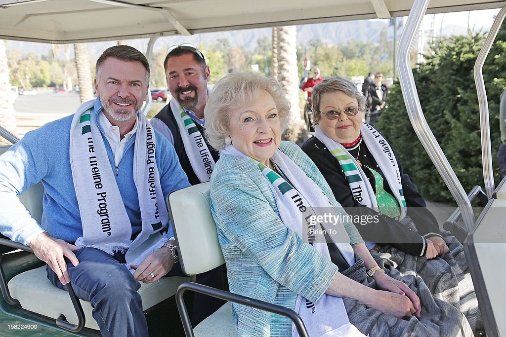 Lifeline Program Founder & CEO Wm. Scott Page, SVP of Market Development & Branding Stephen Terrell, actress Betty White, and winner of The Lifeline Program's national 'Bucket List' Facebook contest Leslie Scott attend Betty 'White Out' Tour at The Los Angeles Zoo with The Lifeline Program at Los Angeles Zoo on December 11, 2012 in Los Angeles, California.