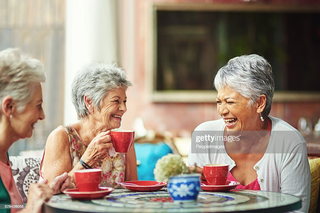 Lifelong friends catching up over coffee : Stock Photo