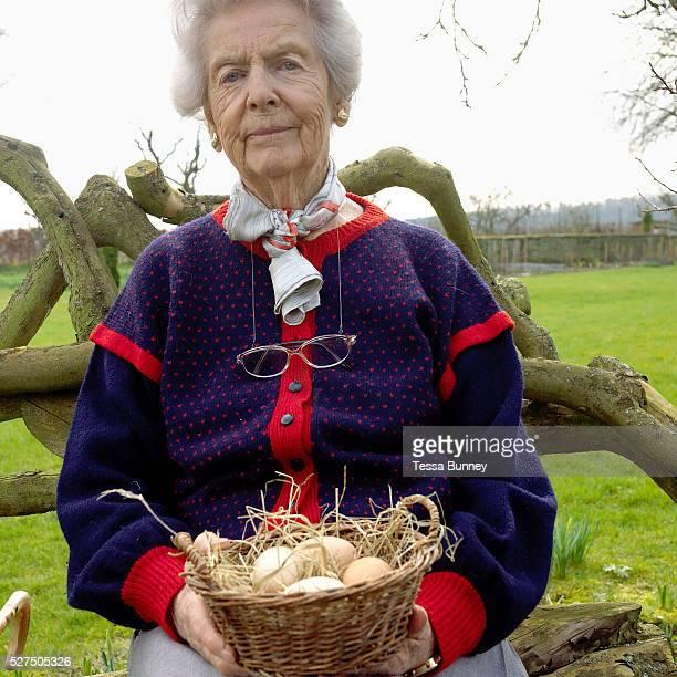 A lifelong lover of chickens Deborah Devonshire holds a basket of hens eggs at her home on the Chatsworth Estate Derbyshire Deborah Vivien Cavendish...