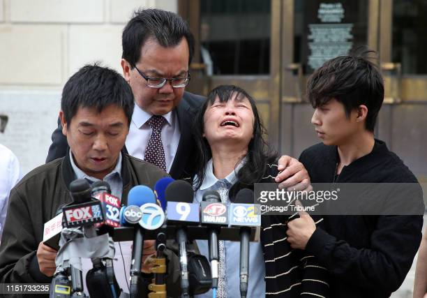 Lifeng Ye, second from right, lets out a wail of grief as her husband Ronggao Zhang, left, the father of slain University of Illinois scholar...