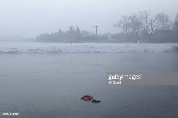 A lifering lies on the partially frozen Great Ouse river on February 11 2012 in Huntingdon England Last night the Met Office recorded the coldest...