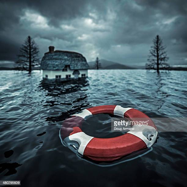 Lifesaver floating by flooded cottage