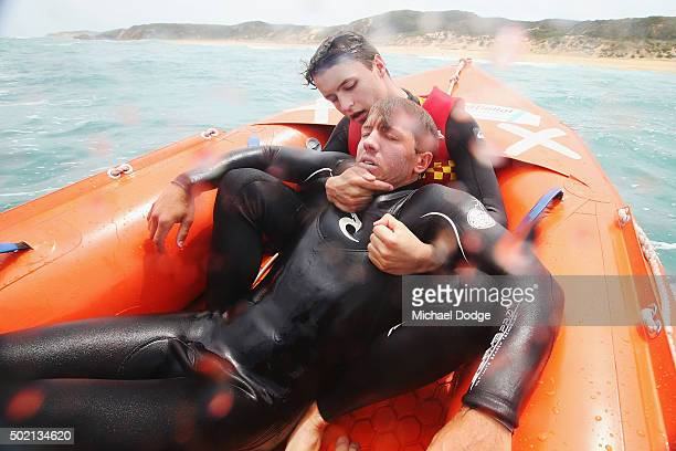 Lifesaver Sam Mellor hauls in fellow lifesaver Nicholas Tissot during a rescue simulation whilst patrolling the Portsea Back Beach on December 6 2015...