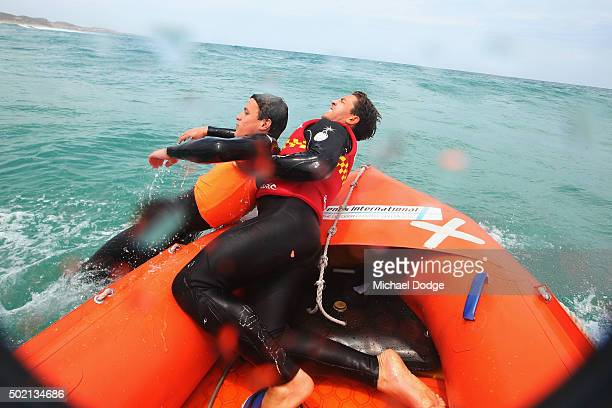 Lifesaver Sam Mellor is hauled in by fellow lifesaver Nicholas Tissot during a rescue simulation whilst patrolling the Portsea Back Beach on December...