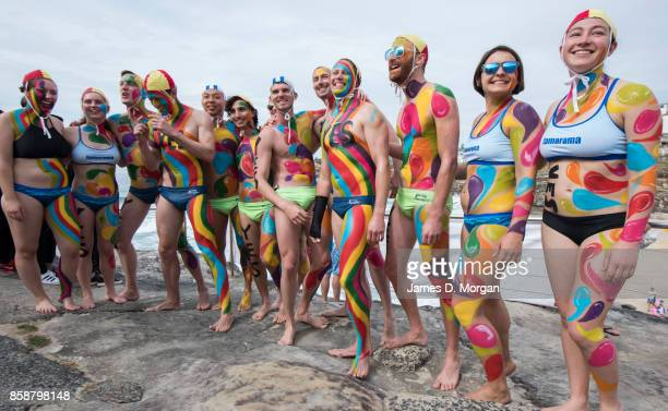 Lifesavers from the Tamarama surf lifesaving club with body paint take part in the Rainbow Walk between Bondi Beach and Bronte Beach on October 8...