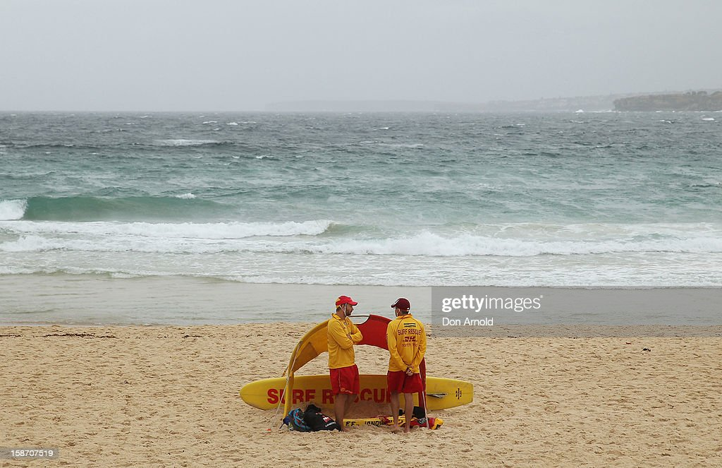 Lifesavers keep watch over a near deserted beach at Bondi Beach on December 25, 2012 in Sydney, Australia. Traditionally beaches such as Bondi Beach are popular destinations for tourists and locals alike to celebrate Christmas Day.