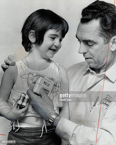 Lifesaving Pacemaker held by John O' Halloran is all that stands between his daughter Rosemarie 5 and death The batterypowered device built by...