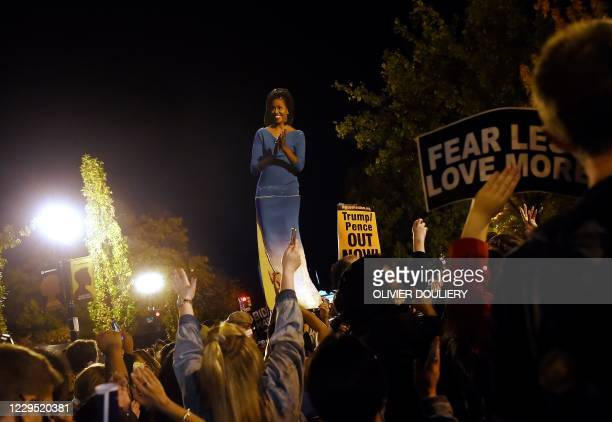 Lifesize cardboard cutout of former First Lady Michelle Obama is seen as people celebrate at Black Lives Matter plaza across from the White House in...