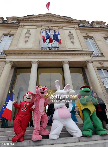 Lifesize cartoon characters Samsam Pink Panther Raving Rabbit and Franklin the Turtle stand on the steps of the Elysee presidential Palace at the end...