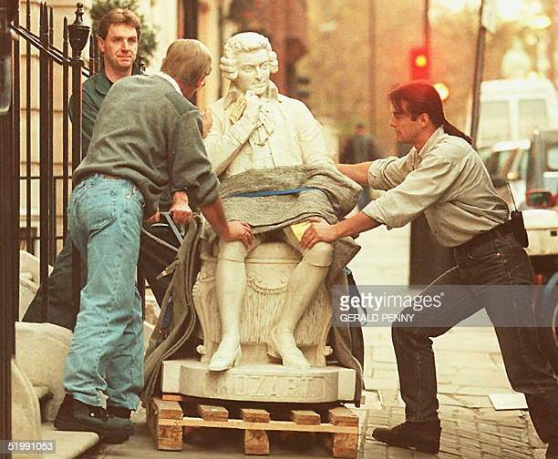 A lifesize figure of composer Wolfgang Amadeus Mozart weighing more than three tons is hauled into Sotheby's auction rooms 15 November The seated...