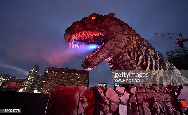 A lifesize Godzilla head on a balcony of the eighth floor of Hotel Gracery Shinjuku is displayed during the official unveiling ceremony at Kabukicho...