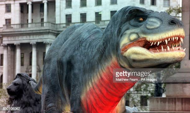 A lifesize model of a TRex prowls among the lions in Trafalgar Square London this morning to promote the new 3D film TRex Back To The Cretaceous...