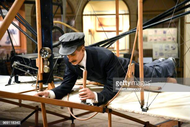 A lifesize model of Orville Wright is shown at the controls of the original 1903 Wright Flyer on display at the National Air and Space Museum in...