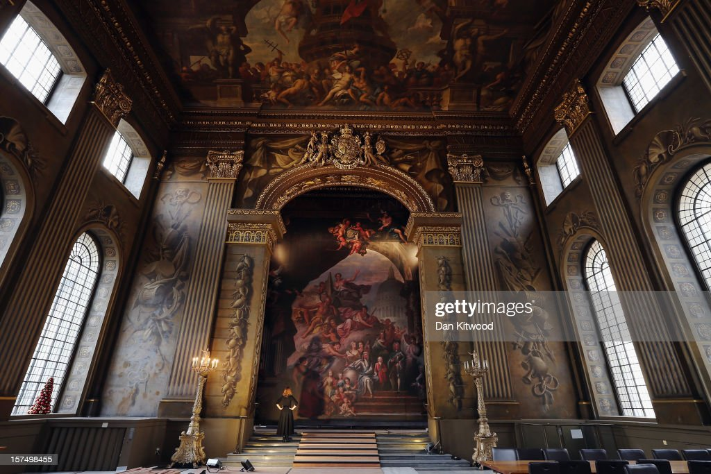 A life-size representation of the west wall in the 'Painted Gallery' is secured into position to hide scaffolding ahead of a conservation project at the Old Royal Naval College, on December 3, 2012 in London, England. The 110 square metre Baroque masterpiece by Sir Christopher Wren and Sir James Thornhill is due to be conserved for the first time in over 50 years, after a major grant from the Heritage Lottery Fund was secured. Central to the painting is the family of King George I, who ascended to the British Throne in 1714 aged 54 and was succeeded by his son George II in 1727.