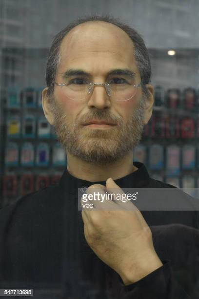 A lifesize silicone sculpture of deceased Apple CEO Steve Jobs is seen at an Apple store on September 4 2017 in Chengdu SIchuan Province of China