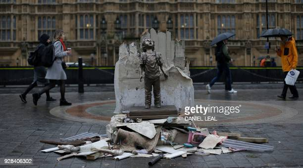 TOPSHOT A lifesize statue of a child is pictured outside of the Houses of Parliament in London on March 7 as part of a demonstration by the charity...