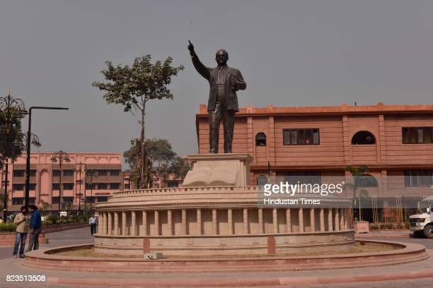 A lifesize statue of Bhimrao Ambedkar and a replica of the Parliament stands at Town Hall square on October 25 2016 in Amritsar India A newly opened...