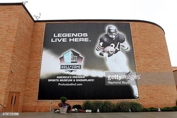 A lifesized banner of Hall of Fame player and former Chicago Bears running back Walter Payton hangs along the wall outside the Pro Football Hall of...