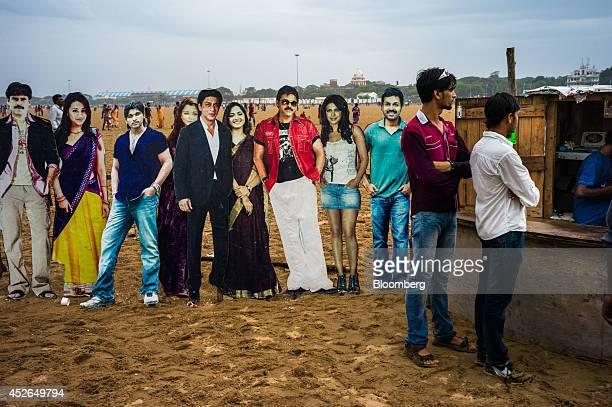 Lifesized cutouts of celebrities are displayed at a makeshift photo studio on Marina Beach in Chennai Tamil Nadu India on Sunday July 20 2014...