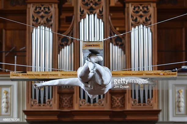 Lifesized fibreglass sculpture of singer Pete Doherty nailed to a crucifix hangs in St Marylebone Parish Church as part of the 'Stations of the...