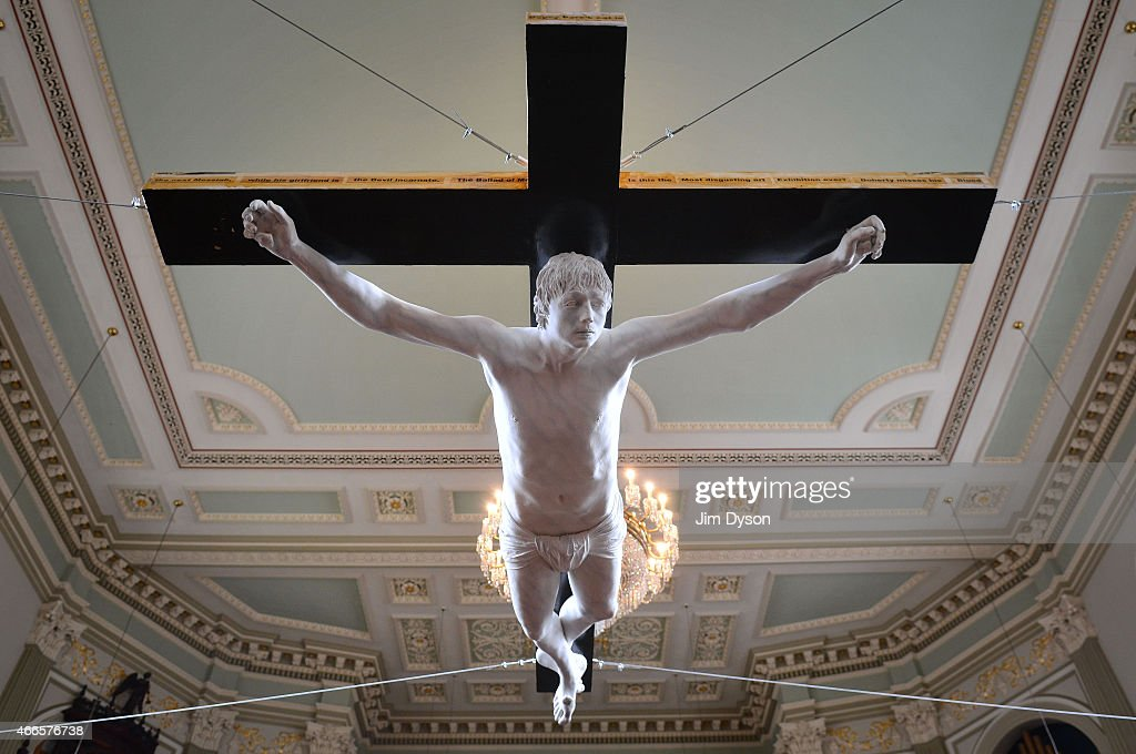 A Life-sized fibre-glass sculpture of singer Pete Doherty nailed to a crucifix hangs in St Marylebone Parish Church as part of the 'Stations of the Cross' exhibition on March 16, 2015 in London, England. The artwork, created by Schoony and Nick Reynolds, entitled 'For Pete's Sake' depicts Doherty's 'crucifixion by the media'. The show has been curated by artist Ben Moore and the exhibits will be auctioned to raise money to continue the search for his brother Tom, who went missing 12 years ago.