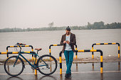 photo handsome man with bike using