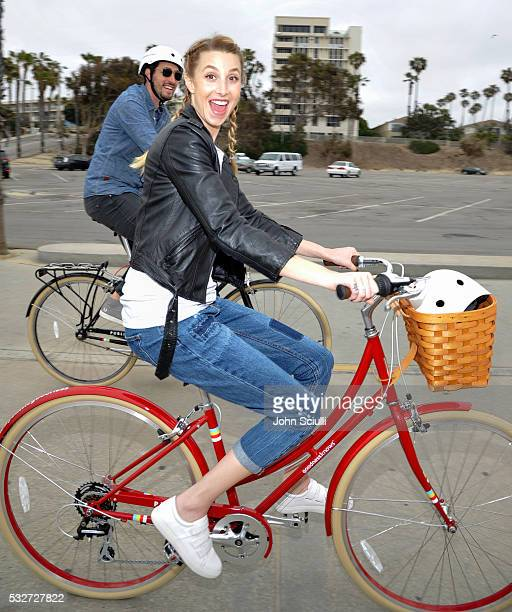 Lifestyle expert and fashion designer Whitney Port and Shaun Boylan of Public Bikes lead a group bike ride with goodnessknows snack squares to...
